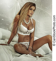 Attractive blonde woman posing in lingerie - Sensual...
