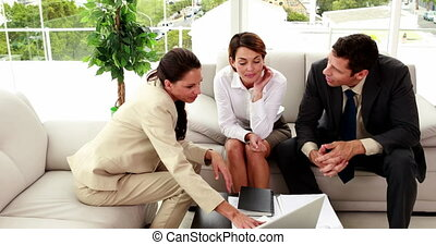Business people having a meeting in staff room in the office