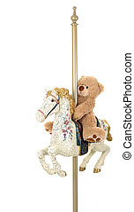 Teddy-Go-Round - A toy bear riding on an antiqued carousel...
