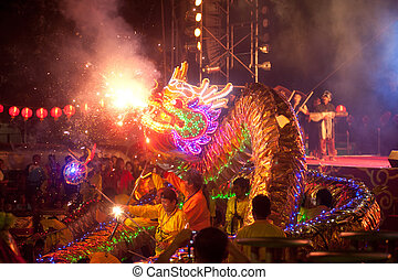 Golden dragon dancing in Chinese New Year