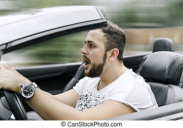 Man driving car - Fright face of man driving car and...