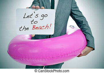 let's go to the beach - businessman with a pink swim ring...