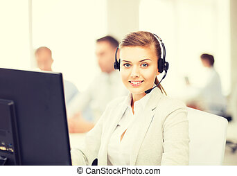 helpline operator with headphones in call centre - friendly...