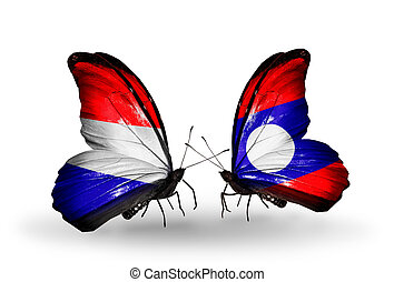 Two butterflies with flags on wings as symbol of relations Holland and Laos