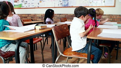 Little children talking in classroom in elementary school