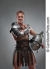 gladiador, armadura, posar, capacete, sobre, cinzento, fundo