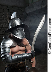 Gladiator in helmet and armour holding sword - Half length...