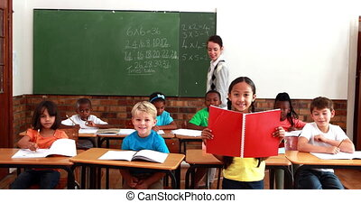 Teacher and pupils smiling at camer