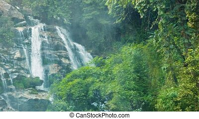 Large waterfall in the jungle near Chiang Rai, Thailand -...