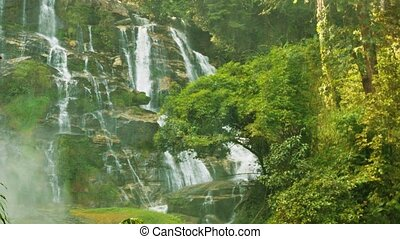 Large waterfall near Chiang Rai, Thailand Vertical pan -...