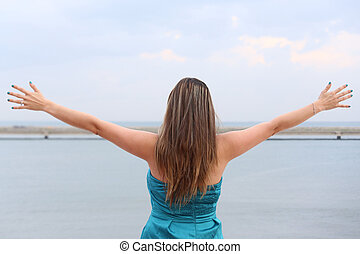 woman standing back with open arms