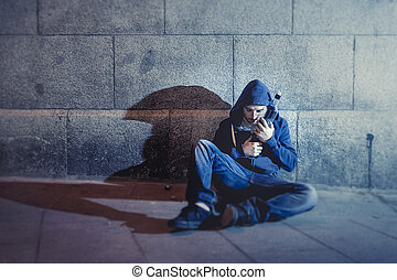 alcoholic grunge man sitting on ground street corner...