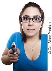 Young girl with funny face pointing gun