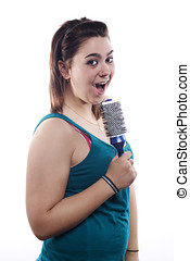 Young brunette singing with her hairbrush as microphone