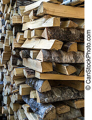 chopped firewood logs in a pile - dry birch chopped firewood...