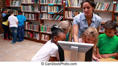 Pupils looking at the computer