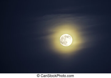 Moon on the background of blue sky Yellow halo