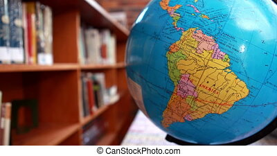 Focus on globe in the library in elementary school