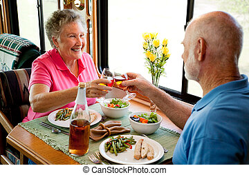 RV Seniors - Romantic Dinner - Senior couple enjoying a...