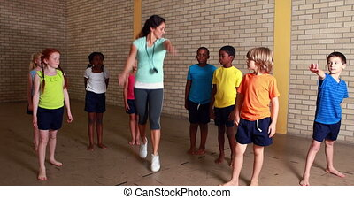 PE teacher with her pupils at the elementary school