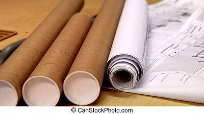 Blueprints on architects desk
