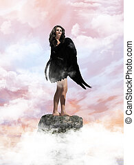 Angel In The Clouds - Angel standing on a rock in the clouds