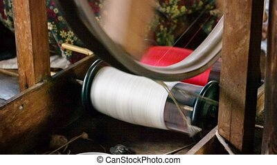 The old spinning wheel in a work process. Burma - Video...
