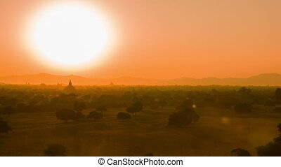 Evening view - architectural complex of Bagan in Burma. Seen a herd of cattle