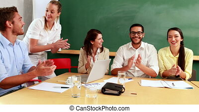 Team clapping at presentation - Casual business team...