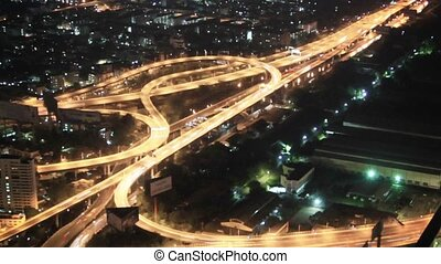 Top view on the night city and highways Bangkok, Thailand -...