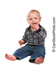 Happy Baby Boy Toddler With Hand in His Mouth