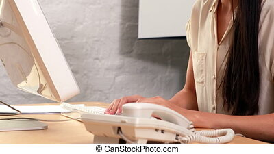 Businesswoman answering the phone - Casual businesswoman...