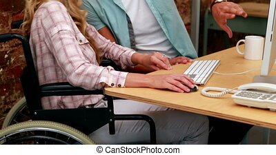Businesswoman in wheelchair working
