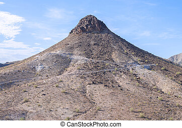 Dome rock - Rugged rocky peak of Dome Rock mountain on hot...