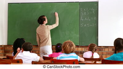 Teacher teaching math to her class - Pretty teacher teaching...