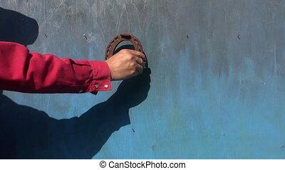 hanging horseshoe and flowers - hanging rusty horseshoe and...