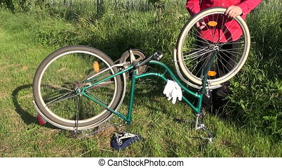 repair old bicycle on farm yard