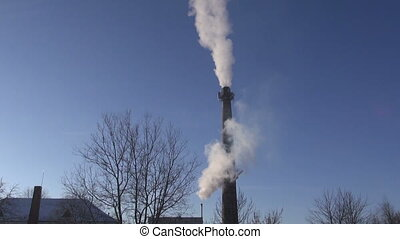 smoke on blue sky background from industrial smokestack
