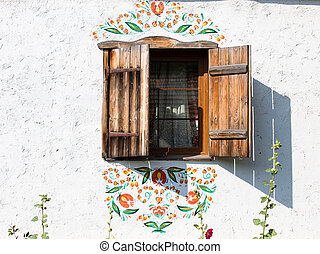 Detail of a window of a typical ukrainian antique house, in...