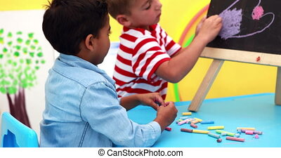 Boys drawing on mini chalkboard - Cute little boys drawing...