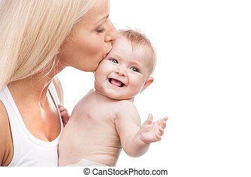 happy mother kissing smiling infant. blond mom and baby on...