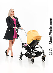 young beautiful mum with baby in stroller beautiful blond...