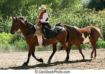 Southwestern Cowgirl - Cowgirl bringing in the horses along...