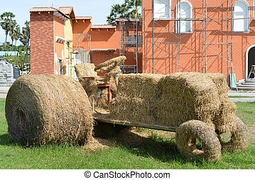 Agricultural wagon with stacked straw bales in the field