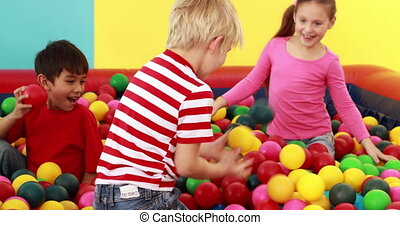 Cute children playing and having fun in the ball pool in...