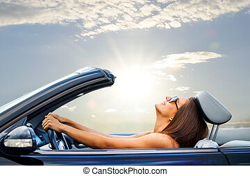 Young girl driving convertible - Portrait of Young girl...