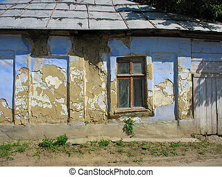 Vintage window,old brown and blue wall, abandoned house