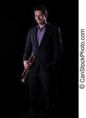 Trumpet player isolated on black background