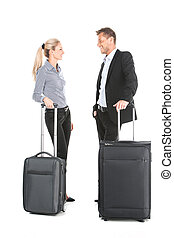 man and woman standing with luggage and talking attractive...
