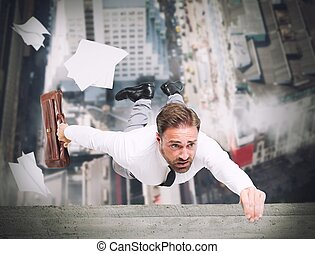Businessman is going to fall from a skyscraper